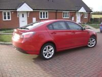 Was immaculate red sporty 4 door saloon/hatchback with 1 year MOT and Just serviced. Small scar now!