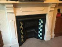 Original Cast Iron Victorian Fire place with wooden surrounding mantelpiece.