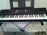 Yamaha full size keyboard with foot pedal and stand as new