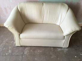 Cream leather 2 seater sofas