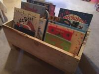 Handmade rustic child raised bookcase