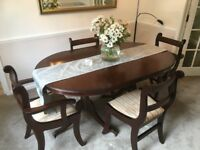 Dining room suite with eight chairs and sideboard.
