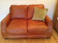Leather two seat sofa in excellent condition, mid brown in colour,