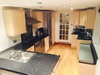 Complete kitchen with range cooker, dishwasher, fridge/freezer, sink and tap