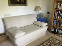 Beige sofa bed in excellent, clean condition.
