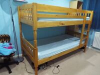 solid pine bunk beds. Excellent condition. Excluding mattresses.