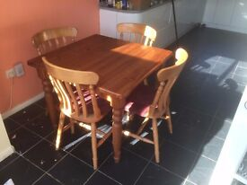 Table & 3 chairs made of beech and Pine good condition cushioned chairs covered with cord