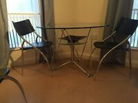 Glass table with metal base and 4 chairs