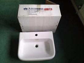 white porcelain bathroom basin