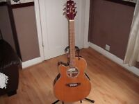 Takamine left handed electro acoustic guitar