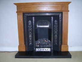 Beautiful Solid Oak surround with Cast Iron inlay & Black Slate Hearth