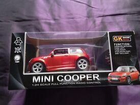Remote control Mini Cooper car in deep metallic red