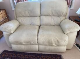 Leather 2 seater sofa - used- 2 electric recliners - marks due to use.