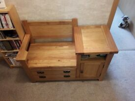 Solid oak hall table with storage and seat. Large drawer, cupboard and shelf. As new. 1 year old.