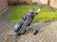 Full set of King cobra golf clubs, bag, trolley and tees