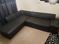 LEATHER CORNER SOFA BED + STORAGE BLACK AND WHITE STICHING GOOD CONDITION 6 MONTHS OLD ONLY