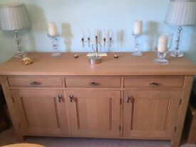 Solid light oak sideboard with three cupboards and three drawers