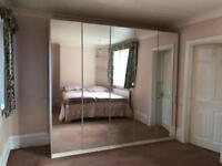 Very large mirrored wardrobe