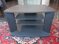 Corner TV table. Black. Excellent clean condition. Free of charge.