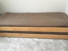 Two single futon beds
