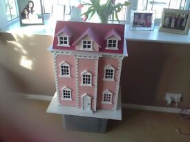 Wooden dolls house brand new from box requires filling with furniture 😉