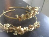 Gold coloured and pearl tiaras
