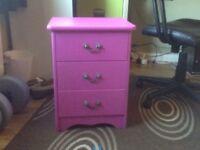Three draw pink bedside unit