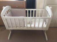 Mammas and pappas swinging crib