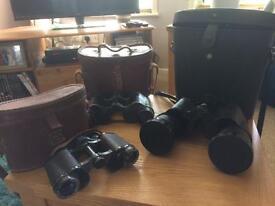Set of three old binoculars