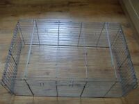 Small animal pet cage with several doors and folding