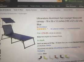 Two new light weight folding sun loungers / camp beds with canopy