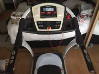Reebok z8 running macheine and weight bench and weights