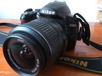 Nikon D3000 Digital SLR Camera with Nikon 18mm - 55mm lens
