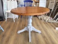 Solid wood round dining table - 4 seater