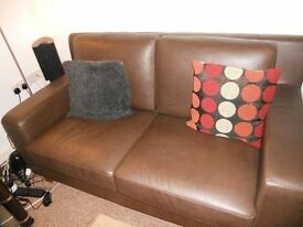 Comfy 2 seater leather sofa in good condition