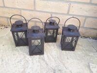 Four black lanterns
