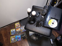 PlayStation 3 with games, controlers, microphones and camera