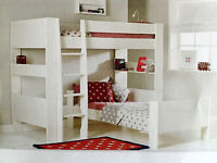 L shaped white bunk beds. High bed not attached to lower single bed .mattresses not included.