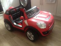 Fab Christmas present! 2 SeAtEr RiDe On CaR. BMW mini. 12v beech comber. Parental remote. Nearly new