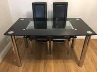 Dinning glass tables with 4 chairs