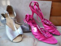Silver and cerise pink dance shoes.