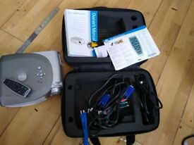 Dell projector. Remote control and official case. As new. 88 hours lamp usage.