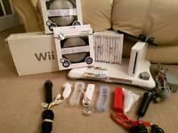 Nintendo Wii + 13 games inc mario kart + balance board + microphones