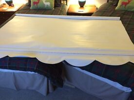 White scalloped edge roller blind may deliver