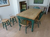 Kitchen/dining room table with 4 chairs and 2 matching stools. With convenient draw for storage.
