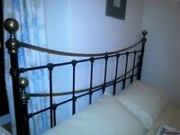 vintage bed frame, brass and black. in good condition