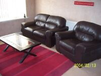 sofa and chair made of leather with matching coffee table