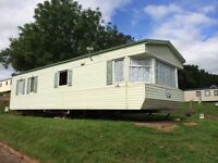 For sale static holiday home £8,995 overlooking Goodrington Sands in South Devon.