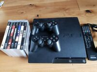 PlayStation 3 with games, 2 controllers and remote