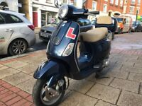 STUNNING PIAGGIO VESPA LX 125cc ie midnight blue 2010 low mileage hpi clear!!